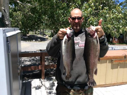 2018-06-09 Harley Wallace caught two fish, 5.5 Lb and 3.25 Lb on Powerworms back of lake. He is from San Diego